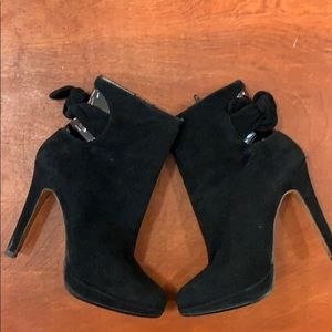 Black suede Bebe booties.